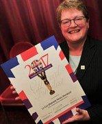Nicky Murdoch DMWS holding her Soldiering on award