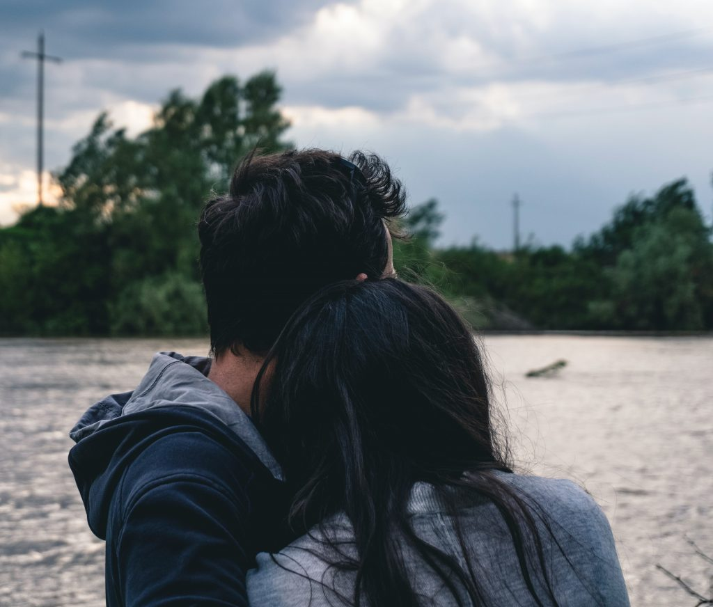photo of couple looking into the distance reflecting